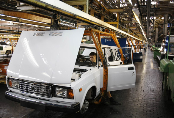 AvtoVAZ employee works at an assembly line of the factory on the Volga River, in Togliatti